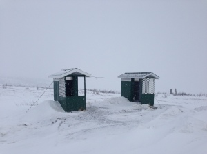 Outhouses secured from the wind with heavy cable